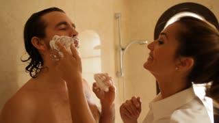 Couple in bathroom, man shaving