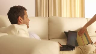 Couple on couch together with computer.