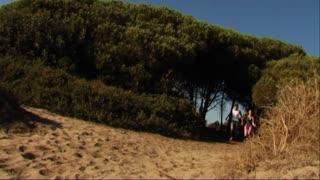 Couple running onto beach
