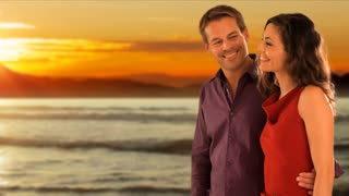 Dolly Shot of couple walking on beach in sunset