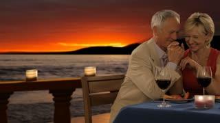 dolly shot of senior couple at dinner in sunset