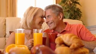 Dolly shot of senior couple enjoying breakfast together.