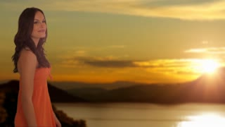 dolly shot of young girl walking in sunset countryside