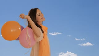 dolly shot of young girl with balloons