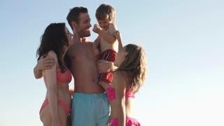 Family group on beach.