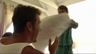 Family having pillow-fight