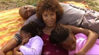 Family in Park hugging