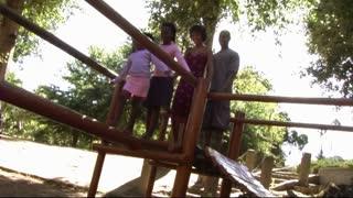 Family in Park on climbing frame
