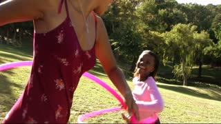 Family in park with hula hoop