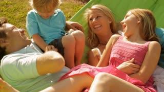 family on garden hammock