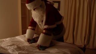 Father Christmas with Christmas stockings.