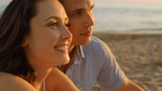 headshot couple on beach