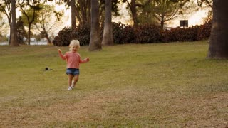 Little girl running to camera in park