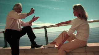 Mature Couple at Beach taking photo