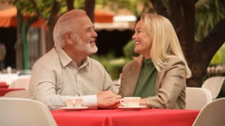 Mature couple in outdoor cafe