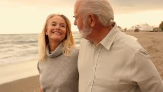 Mature couple on beach walking