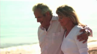 Mature Couple walking on Beach