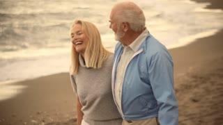 Mature couple walking on beach