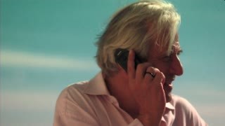 Mature Man on phone at Beach