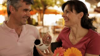 mid aged couple in cafe