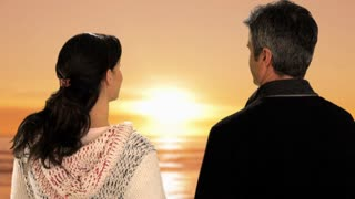 mid aged couple in sunset