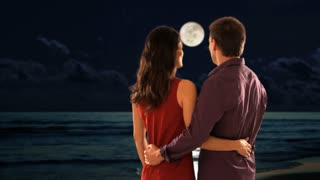 mid aged couple standing in moonlight
