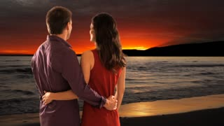 mid aged couple standing in sunset