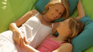 mother and daughter on garden hammock