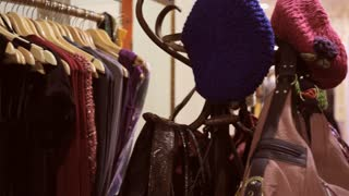 Pan shot of mature couple in shop trying on hat
