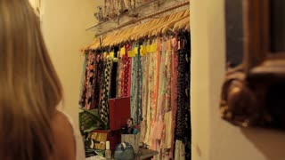 Pan shot of young couple in shop paying for clothes