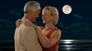 senior couple dancing in moonlight