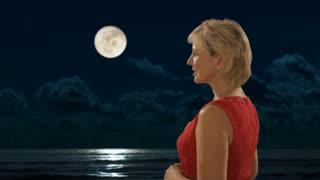 senior couple standing in moonlight