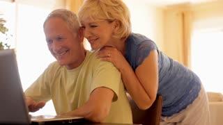 senior couple using laptop computer