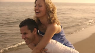 Shot of playing couple on beach.