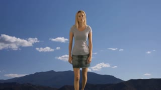 Slow motion of a woman walking outdoors.