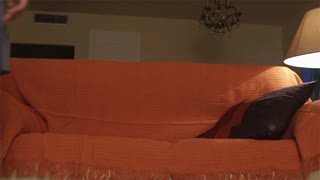 Slow motion shot of woman lying down on couch.