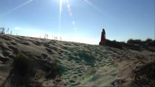 sunburst woman walking on beach