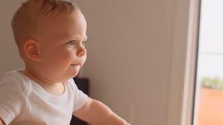 Baby walking indoors