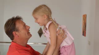 Grandfather and granddaughter falling down of sofa and laughing