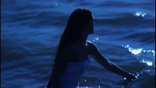 Woman in water gathering flower