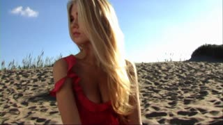 woman on beach with hair blowing in breeze