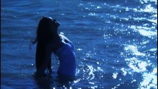 Woman walking through water in a dream