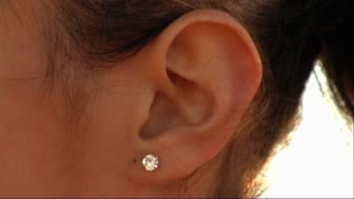 Woman's ear close up