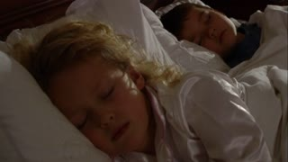 Young Children asleep in bed