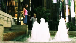 Young Couple in Town at fountain