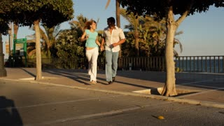 Young couple running towards camera