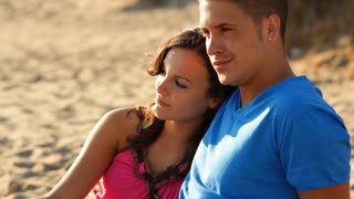 Young couple sitting on beach