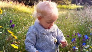 Young girl playing with spring flowers