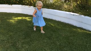 Young girl running round camera by pool