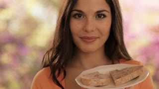 young woman eating bread